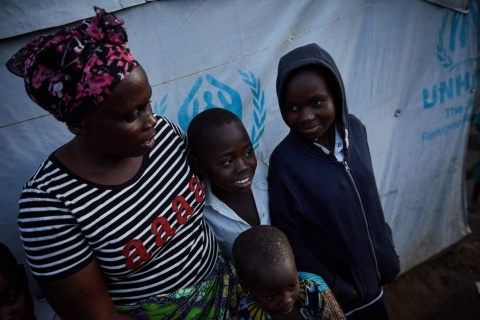 A family in DRC who fled fighting in their village on foot, eventually arriving at a refugee camp hungry and exhausted