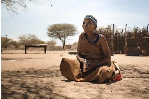 Village elder Ncgabe Taase sitting in her backyard. Credits: Terjo Aaltonen, Location: D'Kar, Botswana.