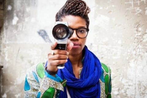 Woman with camera (image by FilmAfrica)