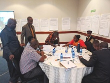 Photo 1: Community stakeholders reviewing background report of Zambian forest tenure context